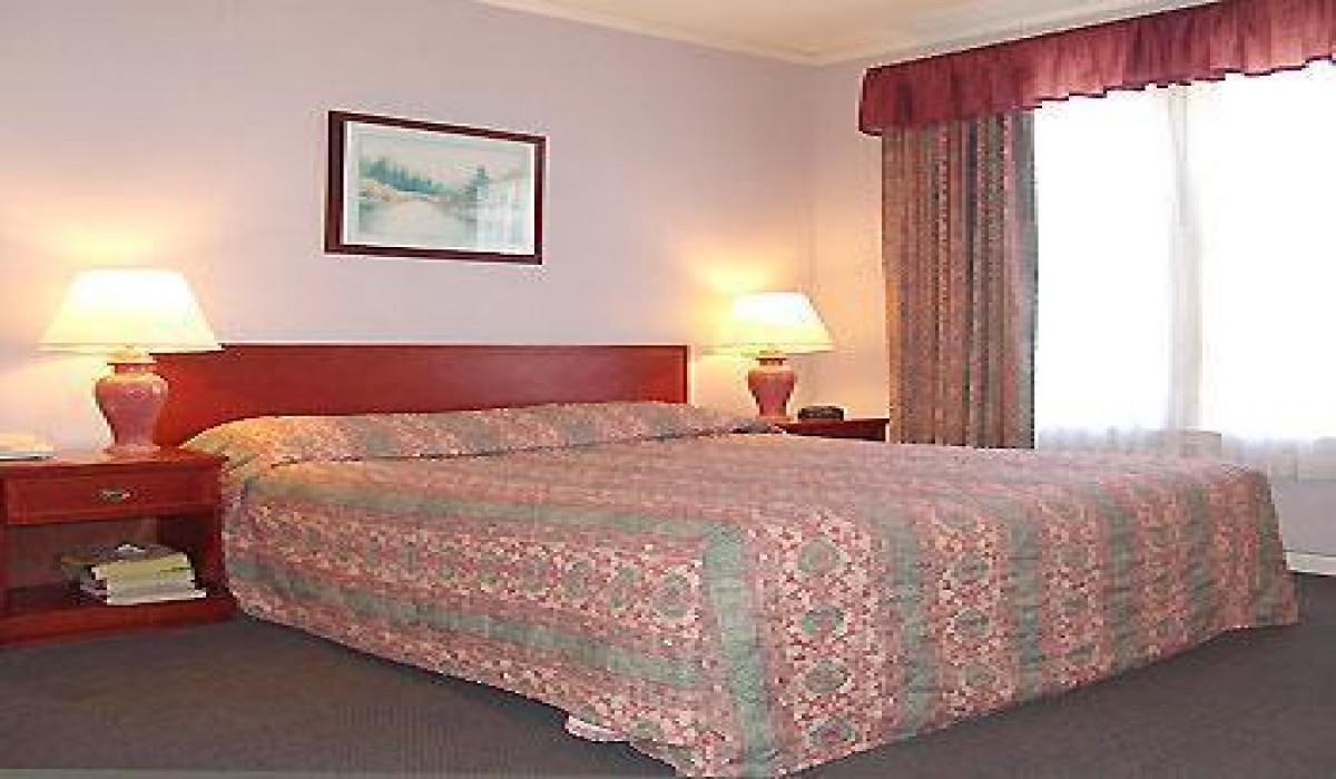 King Bedroom at Alpha Inn & Suites