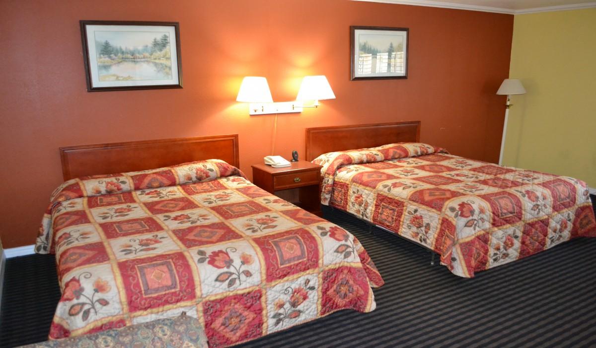 Double Queen Bedroom at Alpha Inn